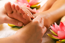 Reflexology on hands and feet